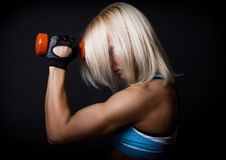 Red dumbbells in hands Stock Photography