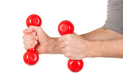 Red dumbbells in the hands of a man, isolated Royalty Free Stock Photography