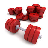 Red dumbbells and heap of weights Royalty Free Stock Image