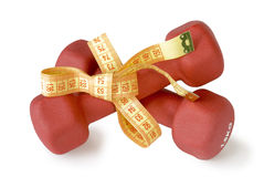 Red dumbbells tied measuring tape Stock Photo