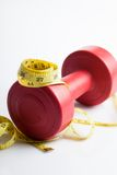 Red dumbbells weight with measuring tape Royalty Free Stock Photo