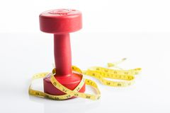 Red dumbbells weight with measuring tape Stock Photo