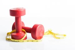 Red dumbbells weight with measuring tape Stock Photography