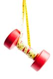 Red dumbbells weight with measuring tape Royalty Free Stock Photos