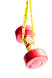 Red dumbbells weight with measuring tape Royalty Free Stock Image