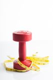 Red dumbbells weight with measuring tape Stock Photos