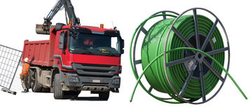 Red dump truck and green telecom tube. Isolated on white background Royalty Free Stock Photos