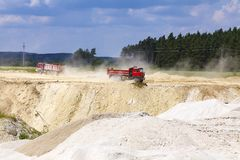 The red dump truck in quarry. The red dump truck. Kaolin quarry in Czech Republic stock image