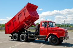 Red dump truck. Kiev, Ukraine - May 26, 2008. Red dump truck with the body lifted for unloading royalty free stock photography
