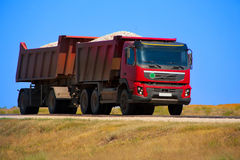 Red dump truck with the trailer royalty free stock photography