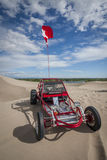 Red Dune Buggy in the sand dunes Royalty Free Stock Image