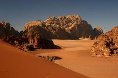 Red dune in Wadi Rum. Red dune and huge rock formations in Wadi Rum desert, Jordan Stock Photo