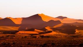 Red dunes of Namib Desert near Sossusvlei, aka Sossus Vlei, Namibia, Africa. Red dunes of Namib Desert near Sossusvlei, aka Sossus Vlei, Namib-Naukluft National Royalty Free Stock Photos