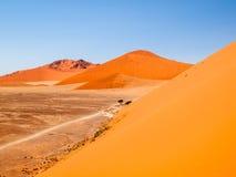 Red dunes of Namib Desert near Sossusvlei, aka Sossus Vlei, Namibia, Africa. Red dunes of Namib Desert near Sossusvlei, aka Sossus Vlei, Namib-Naukluft National Stock Images