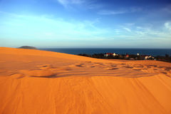 Red dunes, sea and sky. Vietnam Royalty Free Stock Photo