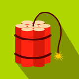 Red dynamite sticks flat icon. On a green background Royalty Free Stock Photo