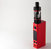 Red E-cigarette or vaping device. Close up. stock image
