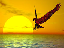 Red Eagle. Surreal red eagle in a brilliant yellow sunset Royalty Free Stock Images