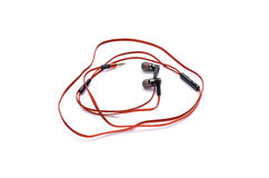 Red earphones isolated on white Stock Images