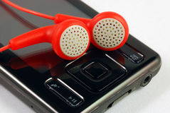 Red earphones on a MP3 player Stock Photography