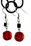 Red earrings Stock Images
