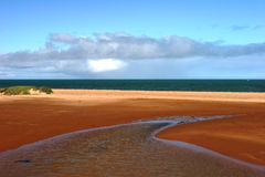 Red earthed estuary and ocean at Carnarvon Royalty Free Stock Photography