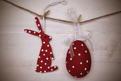 Red Easter Bunny And Easter Egg Hanging On Line With Frame Stock Photo