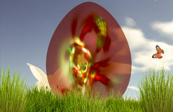 Red Easter Decorative Egg in Fresh Green Grass Stock Images