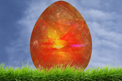 Red Easter Decorative Fractal  Egg in Fresh Green Grass Royalty Free Stock Images