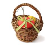 Red Easter egg in a basket Stock Photography