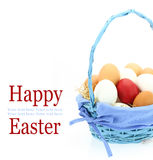 Red Easter egg in the basket. Red Easter egg among fresh eggs in the basket Stock Photography