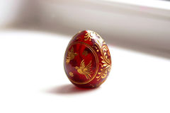 Red Easter egg with a bird pattern. Background Royalty Free Stock Image