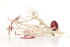 Red Easter egg, branches and cross Stock Photography
