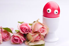 easter egg with eyes and roses Royalty Free Stock Photography