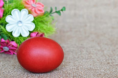 Red Easter egg and fabric flowers Royalty Free Stock Image