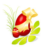 Red Easter egg with golden bow Stock Photos