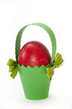 Red easter egg in green carton basket Stock Photo