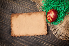Red Easter Egg and old vintage paper card Stock Photo