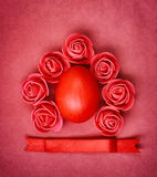 Red easter egg on paper textural background Royalty Free Stock Photo