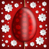 Red Easter egg and white paper flowers Royalty Free Stock Photo