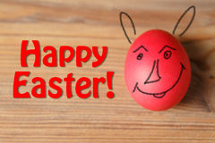 Red easter egg on wooden table Stock Photos