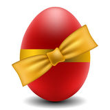 Red Easter egg with yellow bow Stock Photo