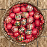Red Easter Eggs. In a basket royalty free stock images
