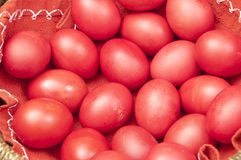 Red Easter eggs in a bowl stock images
