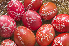 Red Easter eggs in a basket Stock Photography