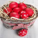 Red Easter eggs in basket Stock Image