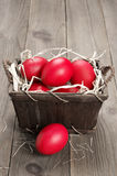 Red Easter eggs in basket Stock Photo