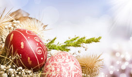 Red Easter eggs on colorful background stock images
