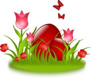 Red easter eggs in grass with flowers and butterflies Stock Photo