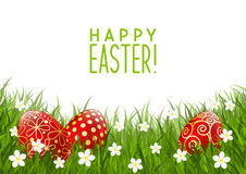 Red Easter eggs on grass Royalty Free Stock Photos